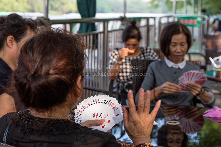 Wenzhou, Zhejiang, China.  Jiangxin Island, Women Playing Cards.