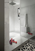 Marble has been used extensively in the design of the large bathrooms