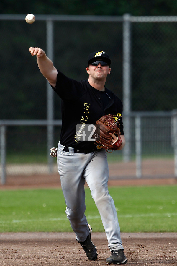 03 September 2011: Seb Visser of  L&D Amsterdam Pirates throws to first base during game 1 of the 2011 Holland Series won 5-4 in inning number 14 by L&D Amsterdam Pirates over Vaessen Pioniers, in Hoofddorp, Netherlands.