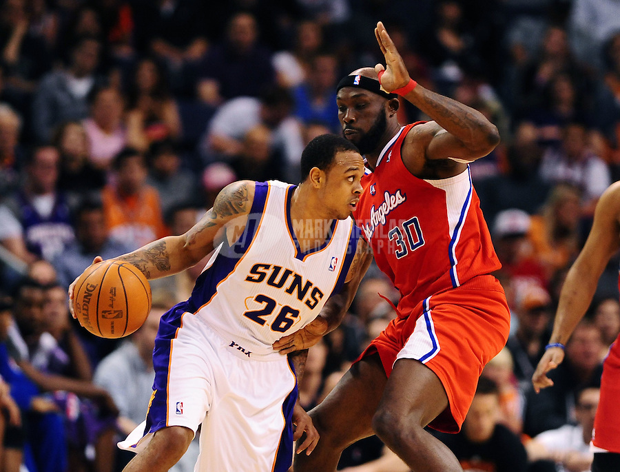 Mar. 2, 2012; Phoenix, AZ, USA; Phoenix Suns guard Shannon Brown (left) controls the ball against Los Angeles Clippers forward Reggie Evans at the US Airways Center. The Suns defeated the Clippers 81-78. Mandatory Credit: Mark J. Rebilas-USA TODAY Sports