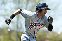 Akron RubberDucks outfielder Tyler Naquin (4) runs to first during a game against the Erie SeaWolves on May 18, 2014 at Jerry Uht Park in Erie, Pennsylvania.  Akron defeated Erie 2-1.  (Mike Janes/Four Seam Images)