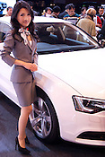 A model stands by an Audi at the Nagoya Motor Show.