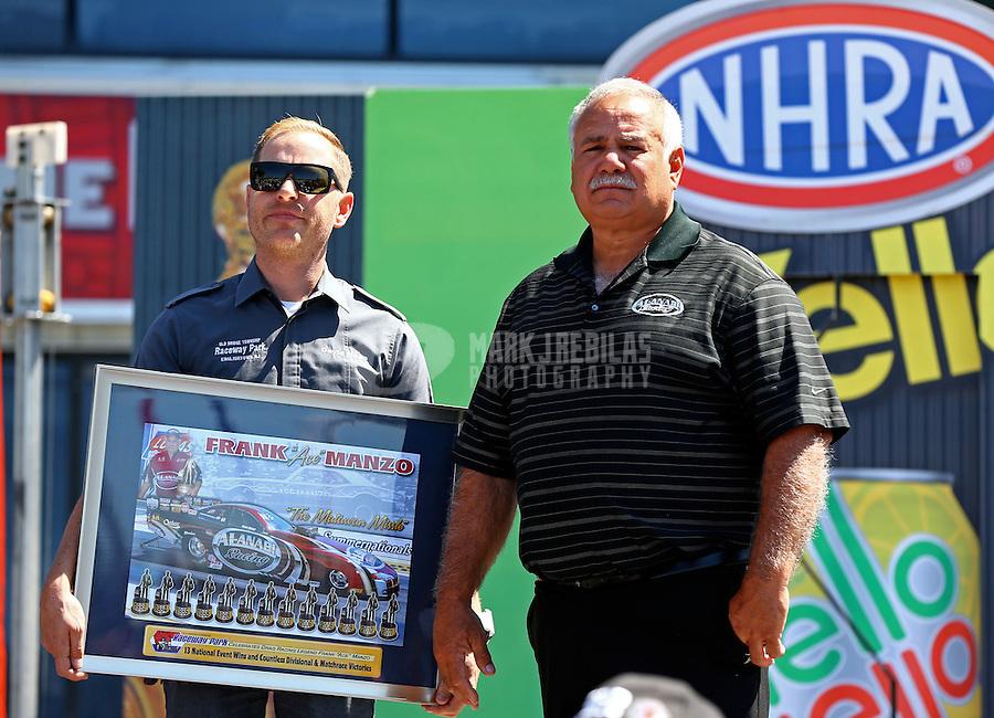 Jun. 1, 2014; Englishtown, NJ, USA; NHRA top alcohol funny car driver Frank Manzo (right) is presented an award by track owner David Napp during the Summernationals at Raceway Park. Mandatory Credit: Mark J. Rebilas-