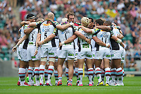 Harlequins huddle together before the Aviva Premiership match between London Wasps and Harlequins at Twickenham on Saturday 1st September 2012 (Photo by Rob Munro).