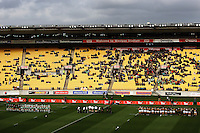 The two teams line up for a minute's silence in memory of victims of the Samoan tsunami disaster. Air NZ Cup - Wellington Lions v Manawatu Turbos at Westpac Stadium, Wellington, New Zealand. Saturday 3 October 2009. Photo: Dave Lintott / lintottphoto.co.nz