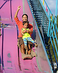 Angel Donna of Vernon and her son Joey, 4, enjoy the ride on the giant slide, during the the seventh annual Vernon Summer Days Carnival, Thursday, July 23, 2015, at the former Golfland on Route 83 on the Vernon Manchester line, the carnival will run through Saturday.  (Jim Michaud / Journal Inquirer)