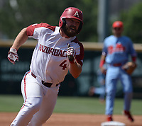 NWA Democrat-Gazette/ANDY SHUPE<br /> Arkansas first basemen Trevor Ezell runs to third Saturday, June 8, 2019, on a single by shortstop Casey Martin during the first inning in the NCAA Super Regional game at Baum-Walker Stadium in Fayetteville. Visit nwadg.com/photos to see more photographs from the game.