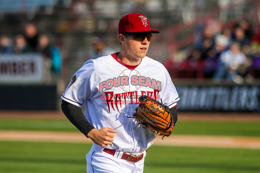 Wisconsin Timber Rattlers outfielder Chad McClanahan (9) jogs to the dugout between innings during a Midwest League game against the Burlington Bees on April 26, 2019 at Fox Cities Stadium in Appleton, Wisconsin. Wisconsin defeated Burlington 2-0. (Brad Krause/Four Seam Images)