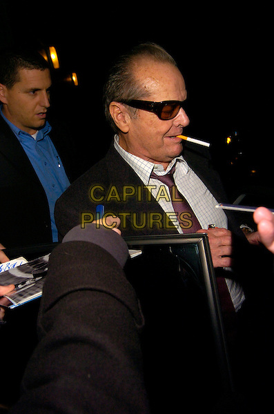 JACK NICHOLSON.Spotted at The Ivy Restaurant, London, England..January 24th, 2008.half length cigarette smoking tinted glasses sunglasses shades signing autographs profile side view .CAP/CAN.©Can Nguyen/Capital Pictures