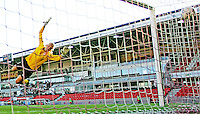 Angela Huckles shot passes Norwegian goalkeeper Erika Skarb¯. USA 4,  Norway 0, Fredrikstad Stadium, July 2, 2008.