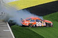 Sept. 28, 2008; Kansas City, KS, USA; Nascar Sprint Cup Series driver Tony Stewart spins during the Camping World RV 400 at Kansas Speedway. Mandatory Credit: Mark J. Rebilas-