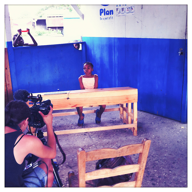 10x10 Field Producer Gina Nemirofsky, filming with a girl in Haiti.