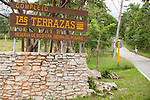 Las Terrazas, Cuba; a rock wall supports the wooden sign at the entrance to Las Terrazas, a sustainable community located in the Sierra del Rosario, a UNESCO declared biosphere reserve