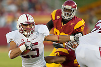 LOS ANGELES, CA-OCTOBER 29,2011- The Stanford Cardinals defeated the USC Trojans 56-48. Tyler Gaffney (25) during play against USC at the L.A. Coliseum in Los Angeles, CA.