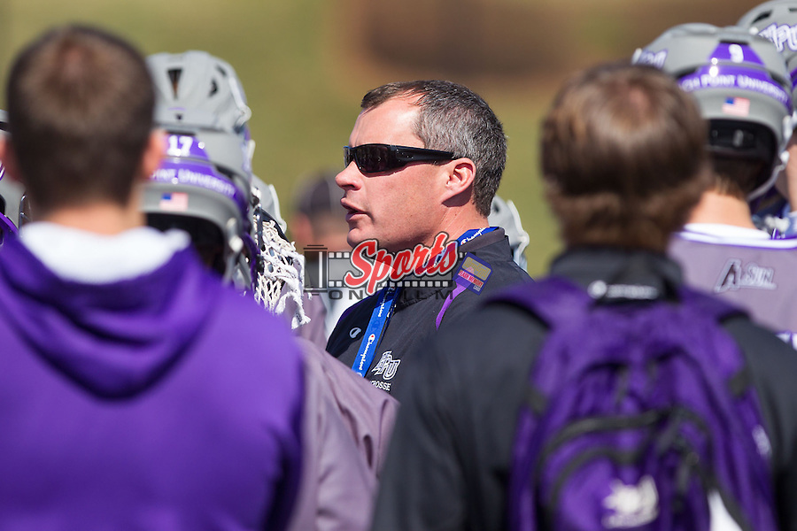 High Point Panthers head coach Jon Torpey talks to his team during a timeout in the game against the UMBC Retrievers at Vert Track, Soccer & Lacrosse Stadium on March 15, 2014 in High Point, North Carolina.  The Panthers defeated the Retrievers 17-15.   (Brian Westerholt/Sports On Film)