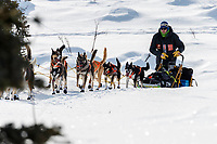 Joar Leifseth Ulsom runs in the afternoon on the trail after leaving the Rainy Pass checkpoint  in the Alaska Range during the 2019 Iditarod on Monday, March 4th 2019.<br /> <br /> Photo by Jeff Schultz/  (C) 2019  ALL RIGHTS RESERVED