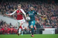 Arsenal's Rob Holding and Southampton's Charlie Austin during the EPL - Premier League match between Arsenal and Southampton at the Emirates Stadium, London, England on 8 April 2018. Photo by Andrew Aleksiejczuk / PRiME Media Images.