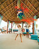 MEXICO, Maya Riviera, girl swinging at a pinyata, Hotel Azul, Yucatan Peninsula