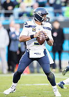 CHARLOTTE, NC - DECEMBER 15: Russell Wilson #3 of the Seattle Seahawks goes back to pass during a game between Seattle Seahawks and Carolina Panthers at Bank of America Stadium on December 15, 2019 in Charlotte, North Carolina.
