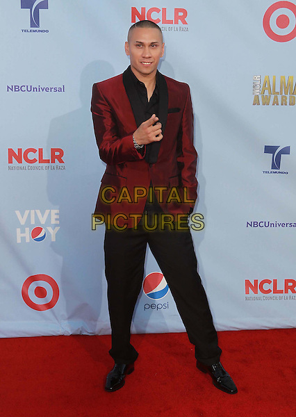 Taboo (Jaime Luis Gomez) of Black Eyed Peas.2012 NCLR ALMA Awards - arrivals, held at The Pasadena Civic Auditorium, Pasadena, California USA..16th September 2012.full length black trousers red suit jacket finger pointing .CAP/ADM/KB.©Kevan Brooks/AdMedia/Capital Pictures.