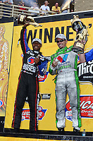 Jul, 22, 2012; Morrison, CO, USA: NHRA top fuel dragster driver Antron Brown (left) and teammate, funny car driver Jack Beckman celebrate after winning the Mile High Nationals at Bandimere Speedway. Mandatory Credit: Mark J. Rebilas-US PRESSWIRE