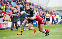 Picture by Allan McKenzie/SWpix.com - 07/04/2018 - Rugby League - Betfred Super League - Salford Red Devils v Warrington Wolves - AJ Bell Stadium, Salford, England - Warrington's Josh Charnley fends off Salford's Derrell Olpherts.