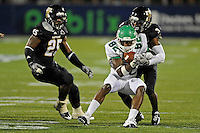 1 September 2011:  FIU defensive back Richard Leonard (3) tackles North Texas wide receiver Michael Outlaw (82) in the second half as the FIU Golden Panthers defeated the University of North Texas, 41-16, at University Park Stadium in Miami, Florida.