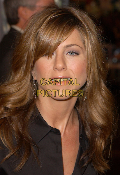 JENNIFER ANISTON  .Universal Pictures World Premiere of Along Came Polly held at the Grauman's Chinese Theater .*UK Sales Only*.12 January 2004.portrait, headshot, fringe, hair.www.capitalpictures.com.sales@capitalpictures.com.©Capital Pictures.