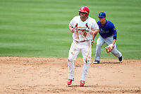 Chris Swauger (8) of the Springfield Cardinals takes a lead off of second base during a game against the Tulsa Drillers at Hammons Field on June 27, 2011 in Springfield, Missouri. (David Welker / Four Seam Images)