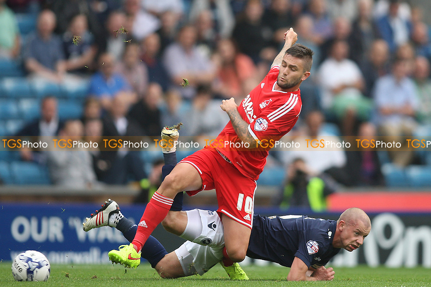 Henri Lansbury of Nottingham Forest and Alan Dunne of Millwall in a tussle - Millwall vs Nottingham Forest - Sky Bet Championship Football at the New Den, Bermondsey, London - 20/09/14 - MANDATORY CREDIT: George Phillipou/TGSPHOTO - Self billing applies where appropriate - contact@tgsphoto.co.uk - NO UNPAID USE