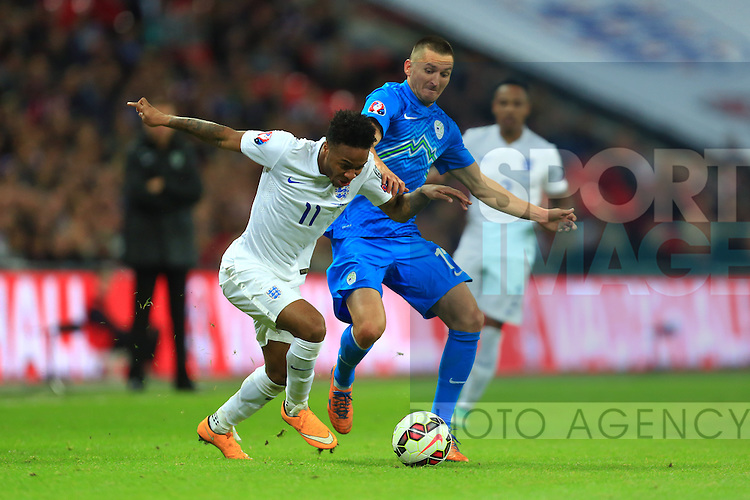 Raheem Sterling of England battles Andraz Kirm of Slovenia - England vs. Slovenia - UEFA Euro 2016 Qualifying - Wembley Stadium - London - 15/11/2014 Pic Philip Oldham/Sportimage