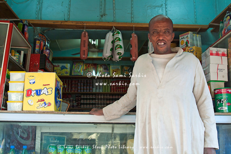 Portrait of a shopkeeper in his grocery store, Al-Qusair, Egypt.