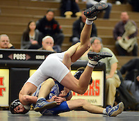 WARMINSTER, PA -  JANUARY 8:   William Tennent's Jesse Coleman (L) and Bensalem's Tommy Stokes (R) battle during the 138 lb wrestling match January 8, 2014 at William Tennent high school in Warminster, Pennsylvania.  (Photo by William Thomas Cain/Cain Images)