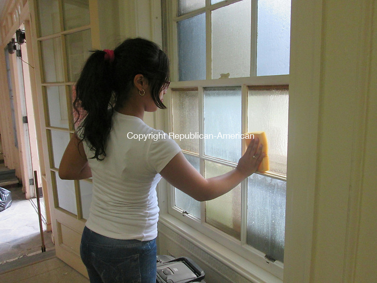 WATERBURY,CT- 4 June 2015 -060415DL02--  Raquel Robles, a L.A.C.E. participant and sixth grader at North End Middle School cleaned the windows of the new Hispanic Cultural Center in dwntown. The center is expected to be open to the public by the end of the month. Destiny Lopez Republican-American