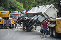 NWA Democrat-Gazette/ANTHONY REYES • @NWATONYR<br /> Logan Skaggs, left, and Tommy Turner, both with Decatur Salvage and Wrecker, roll an 18-wheeler upright Wednesday, Sept. 9, 2015 on Highway 72 in Centerton. The 18-wheeler, which was hauling a load of gravel, was traveling east on Highway 72 when it failed to properly handle and turn and rolled onto its side. Much of the load was thrown down the embankment south of the highway. There were no injuries in the accident.