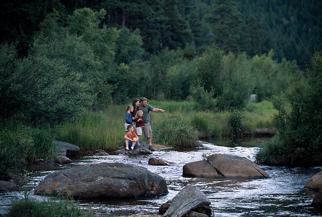 Family of five explore river habitat along Big Thompson River, Moraine Park, Rocky Mtn Nat'l Park, CO