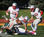 SPEARFISH, SD - OCTOBER 10, 2015 -- Austin Ekeler #31 of Western State Colorado gets upended by a Black Hills State defender during their college football game Saturday at Lyle Hare Stadium in Spearfish, S.D. Also pictured are A.J. Pinterpe #71 and Kyle Adkins 13 of Western State Colorado. (Photo by Dick Carlson/Inertia)