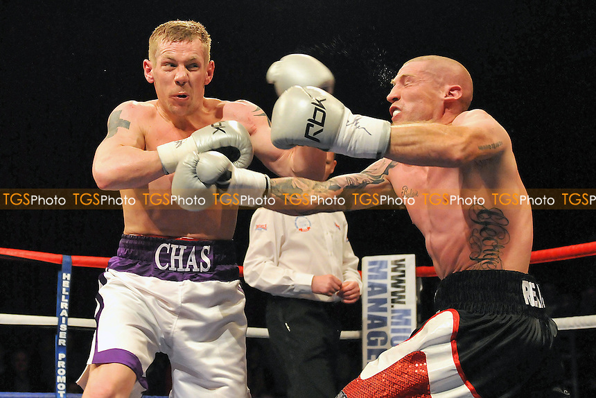 Chas Symonds (white shorts) defeats Darryl Still in a Welterweight boxing contest for the Southern Area title at The Coronet Theatre, London promoted by Mickey Helliet - 20/04/12 - MANDATORY CREDIT: Philip Sharkey/TGSPHOTO - Self billing applies where appropriate - 0845 094 6026 - contact@tgsphoto.co.uk - NO UNPAID USE.