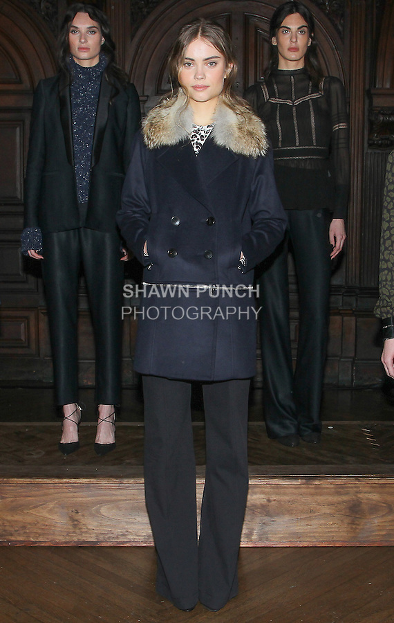 """Model Daria poses in a snow leopard print Georgette pintuck Henley blouse, dark navy wool cashmere convertible Peacoat with detachable fur collar, and black stretch techno twill utility pant, from the Veronica Beard Fall 2016 """"Gypsy Caravan"""" collection presentation, at the Highline Hotel on February 15 2016, during New York Fashion Week Fall 2016."""