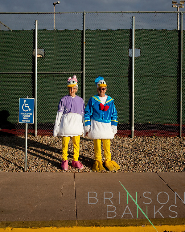 "Lucille Rogers, 85, and Linda Haugland, 63, stand in duck costumes to promote a Duck Race for charity outside of the Lakeview Recreation Center December 11, 2009. ""It's always a weekend here,"" Ms Haugland said of Sun City. She is a second-generation Sun Citian, visiting her mother in Sun City is what made her decide to move there."