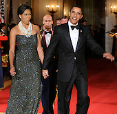 Washington, DC - February 22, 2009 -- United States President Barack Obama walks with first lady Michelle Obama as they enter the East Room for entertainment after a black-tie dinner at the White House for the nation's governors, Sunday, February 22, 2009.  The National Governors Association has been holding their 2009 Winter Meeting this weekend, where the nation's governors have been discussing Obama's stimulus program, as well as health care, infrastructure and education.      .Credit: Mike Theiler - Pool via CNP