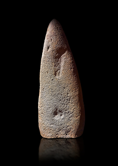 Late European Neolithic prehistoric Menhir standing stone which represents a standing figure. Excavated from Bau Carradore III site,  Laconi. Menhir Museum, Museo della Statuaria Prehistorica in Sardegna, Museum of Prehoistoric Sardinian Statues, Palazzo Aymerich, Laconi, Sardinia, Italy. Black background.