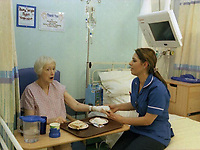 A nurse tends to her patient on a hospital ward. Date: 31.10.2005. <br />