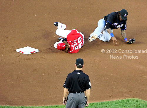 New York Mets shortstop Jose Reyes (7) is knocked down by a hard slide from Washington Nationals right fielder Jayson Werth (28) in fourth inning action at Nationals Park in Washington, D.C. on Saturday, July 30, 2011.  Reyes was able to rush the throw to complete the double play.  The Nationals won the game 3 - 0..Credit: Ron Sachs / CNP.(RESTRICTION: NO New York or New Jersey Newspapers or newspapers within a 75 mile radius of New York City)