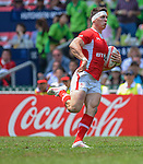 Wales vs New Zealand on Day 3 of the 2012 Cathay Pacific / HSBC Hong Kong Sevens at the Hong Kong Stadium in Hong Kong, China on 25th March 2012. Photo © Ricardo Ordonez  / The Power of Sport Images