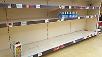Pictured: Empty shelves in the beer section iin the Sainsbury's super market, in Swansea, Wales, UK. <br /> Re: Covid-19 Coronavirus pandemic, UK.