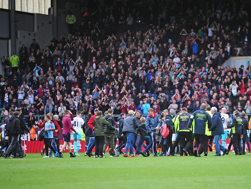 Burnley fans invade the pitch at the final whistle<br /> <br /> Photographer Andrew Vaughan/CameraSport<br /> <br /> The Premier League - Burnley v West Ham United - Sunday 21st May 2017 - Turf Moor - Burnley<br /> <br /> World Copyright &copy; 2017 CameraSport. All rights reserved. 43 Linden Ave. Countesthorpe. Leicester. England. LE8 5PG - Tel: +44 (0) 116 277 4147 - admin@camerasport.com - www.camerasport.com