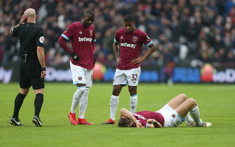 West Ham United's Xande Silva and Pedro Obiang look over the injured Andy Carroll<br /> <br /> Photographer Rob Newell/CameraSport<br /> <br /> Emirates FA Cup Third Round - West Ham United v Birmingham City - Saturday 5th January 2019 - London Stadium - London<br />  <br /> World Copyright © 2019 CameraSport. All rights reserved. 43 Linden Ave. Countesthorpe. Leicester. England. LE8 5PG - Tel: +44 (0) 116 277 4147 - admin@camerasport.com - www.camerasport.com