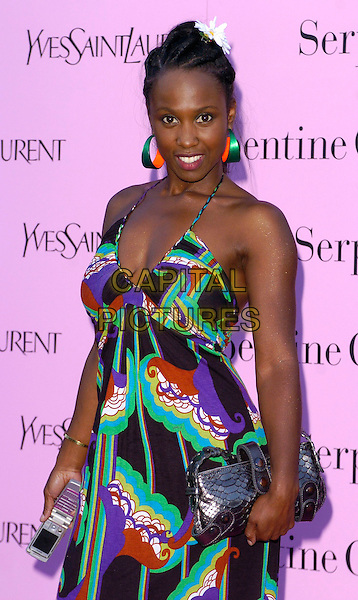 MICHELLE GAYLE.Serpentine Gallery Summer Party, London, UK..July 11th, 2006.Ref: CAN.half length black green pattern dress metallic purse halterneck earrings.www.capitalpictures.com.sales@capitalpictures.com.©Capital Pictures