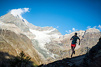 Trail running with the Weisshorn  in the distance, while on the Via Valais, a multi-day trail running tour connecting Verbier with Zermatt, Switzerland.
